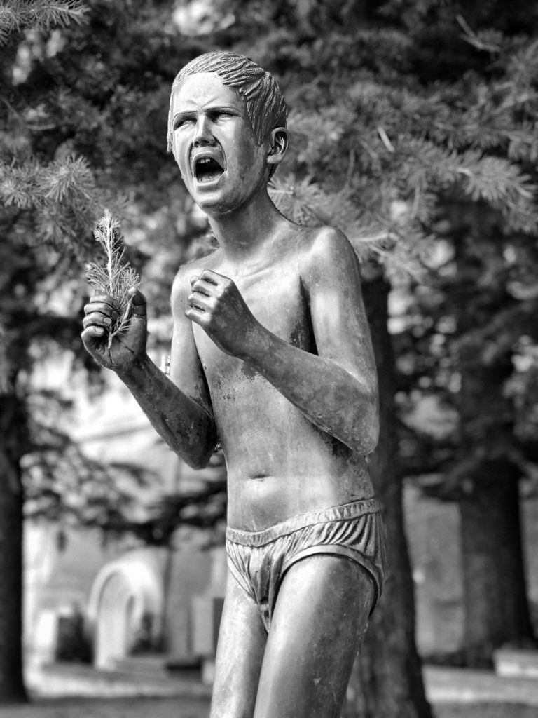 Statue of young boy in anguish