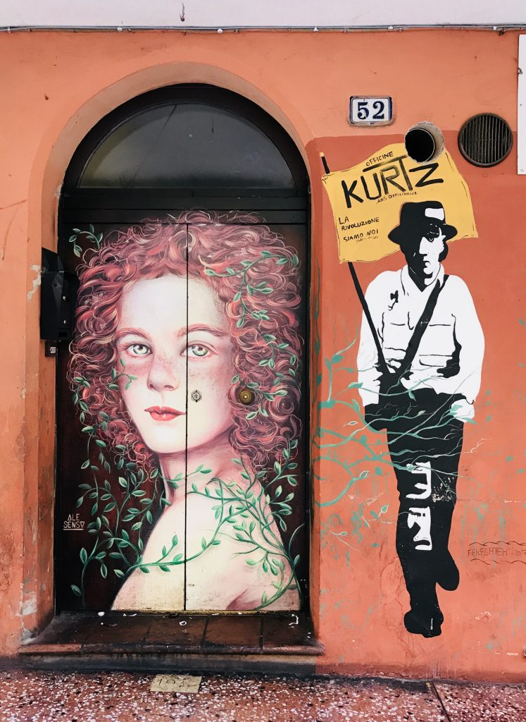 street art painted on shop shutters in Via Del Pratello Bologna Italy, beautiful lady