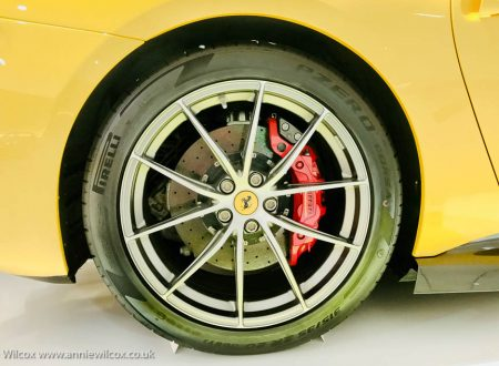 Annie_Wilcox_Photography_travelling_with_a_camera_Ferrari_Museum_Modena_Italy_wheel