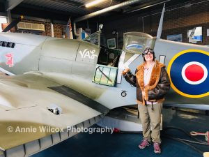 Annie Wilcox dressed as Biggles by a Spitfire at Spitfire & Hurricane Memorial Museum